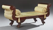 American Classical Carved Mahogany Window Seat, 19th c., the bench seat flanked by double scrolled acanthus leaf arms, over winged f...