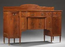 American Inlaid Mahogany Bowfront Sideboard, 19th c., the arched back to a bowed top over a center drawer flanked by four drawers ov...