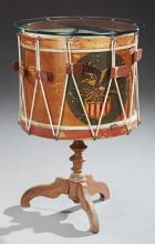 American Polychrome Drum Side Table, late 19th c., the drum painted with an eagle and flag shield, now with a circular glass top and...