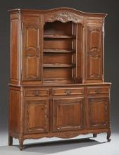 French Provincial Carved Oak Louis XV Style Buffet a Deux Corps, 19th c., the stepped arched crown over central setback plate racks...