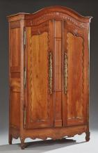 French Provincial Louis XV Style Carved Cherry Armoire, early 19th c., the arched canted corner crown over double arched paneled doo...