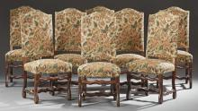 Set of Eight Louis XIII Style Carved Beech Dining Chairs, 19th c., the arched high backs over trapezoidal seats, on cabriole legs wi...
