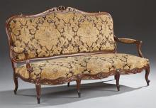 Louis XV Style Carved Walnut Settee, 19th c., the serpentine crest rail over upholstered back, arms, and seat, on scrolled cabriole...