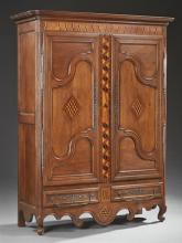 French Provincial Louis XV Style Inlaid Oak Armoire, c. 1800, the stepped rounded corner ogee crown over two triple panel doors with...