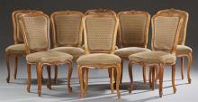 Set of Eight French Louis XV Style Upholstered Carved Beech Dining Chairs, 20th c., the arched highbacks to upholstered bowed seats...