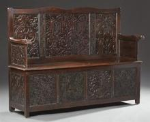 French Carved Oak Medieval Style Settle, c. 1800, the serpentine crest rail over three elaborate relief carved panels, to relief arm...