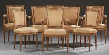 Set of Eight French Louis XVI Style Carved Beech Dining Chairs, consisting of six fauteuils and two side chairs, the curved upholste...