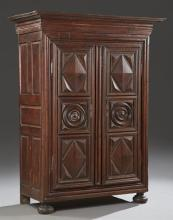 French Louis XIII Style Carved Oak Armoire, 19th c., the stepped dentillated crown over double doors with high relief geometric carv...