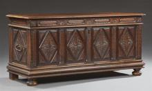 French Provincial Carved Walnut Coffer, early 19th c., the rounded edge top over floral relief carved front and side panels, the sid...