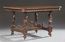 French Provincial Carved Oak Dining Table, 19th c., Brittany, the carved edge rounded corner top over a foliate carved skirt, on fig...