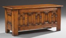 English Style Carved Oak Bedding Box, 20th c., with an arched panel front flanked by reeded sides, H.- 20 1/2 in., W.- 44 1/2 in., D...