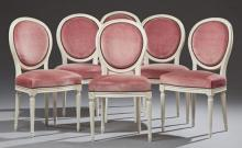 Set of Six French Louis XVI Style Polychromed Dining Chairs, 20th c.,the medallion backs over bowed seats on turned tapered reeded l...