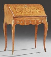 French Louis XV Style Marquetry Inlaid Ormolu Mounted Mahogany Secretary, 20th c., the slant lid with an inset gilt tooled leather w...