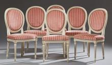 Set of Six French Polychromed Beech Louis XVI Style Dining Chairs, 20th c.,the oval medallion back over a bowed seat, on turned tape...