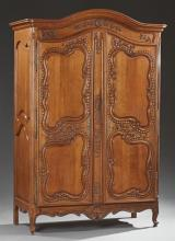 Unusual French Provincial Carved Oak Louis XV Style Armoire, 19th c., the stepped arched rounded corner crown over double arched two...
