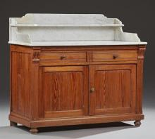 French Provincial Pitch Pine Marble Top Washstand, c. 1880, the figured white marble with a rear shelf and splash sides, on a base w...