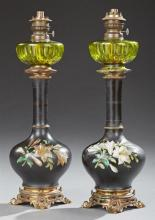 Pair of French Ceramic Oil Lamps, c. 1870, with green glass fonts over bottle form vases with enameled floral decoration, on bronze...