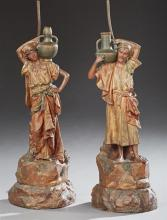 Pair of Figural Earthenware Lamps, early 20th c., in the form of Arabic male and female water bearers, on integral bases, Figures- H...