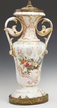 Old Paris Porcelain Baluster Vase, 19th c., with gilt decoration and a floral reserve and applied leaf handles, to a scalloped base,...