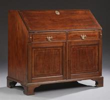 Large English Inlaid Mahogany Slant Front Secretary, 19th c., the slant lid with a baize lined writing surface enclosing an interior...