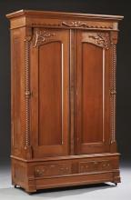 American Eastlake Carved Walnut Armoire, c. 1890, the stepped crown over double paneled doors, with applied carving, flanked by pila...