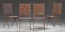 Set of Four Wrought Iron Patio Side Chairs, late 20th c., with woven strap work backs and seats, on tubular legs joined by stretcher...