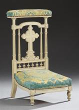 French Polychromed Carved Beech Prie Dieu, 19th c., the upholstered arm rest over a cross back splat, to a bowed seat, on turned leg...