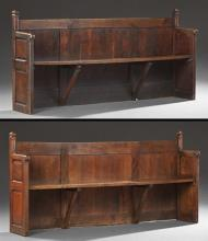 Pair of French Provincial Carved Oak Church Pews, 19th c., the backs with square pointed finials over fielded panel sides joined by...