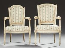 Pair of French Louis XVI Style Polychromed Fauteuils, late 19th c., the arched curved back over upholstered arms and a bowed seat, o...