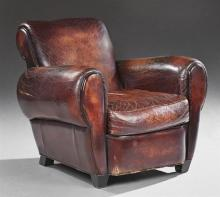 Leather Club Chair, 20th c., with rolled arms and back, on square ebonized legs, H.- 34 in., W.- 36 in., D.- 41 in.
