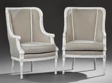 Pair of Louis XVI Style Polychromed Bergeres, 20th c., the arched curved upholstered backs to scrolled arms and cushion seats, on tu...