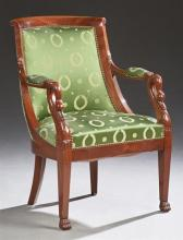 French Empire Style Carved Mahogany Upholstered Fauteuil, 20th c., the curved back flanked by swan carved arms, to an upholstered se...
