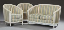Three Piece French Louis XVI Style Polychromed Parlor Suite, 20th c., consisting of a two seat settee with a curved back over bowed...
