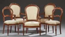 Set of Five French Carved Mahogany Chairs, early 19th c., consisting of three fauteuils with floral caned crests, scrolled arms and...