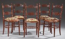 Set of Five French Carved Mahogany Side Chairs, c. 1870, the pierced arched back and splat, over bowed upholstered seats on turned t...