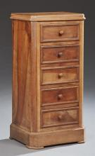 French Louis Philippe Carved Walnut Nightstand, 19th c., the stepped canted corner top over a frieze drawer above a double faux draw...