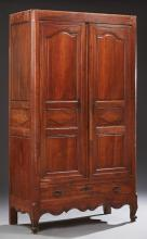 French Provincial Louis XV Style Carved Walnut Armoire, early 19th c., the canted corner top over two triple fielded panel doors, ab...
