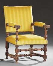 French Carved Walnut Renaissance Style Fauteuil, early 20th c., the square back over upholstered arms with dragon carved terminals,...