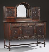 American Jacobean Style Carved Oak Sideboard, early 20th c., the arched bowed back with a central mirror flanked by rope twist suppo...