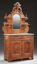 American Victorian Carved Oak Marble Top Sideboard, c. 1890, the arched pierced fruit carved crest over an arched beveled mirror fla...