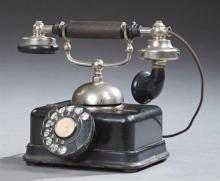 L. M. Ericsson Dial Telephone, early 20th c., now wired for use in America and in working order, H.- 9 in., W.- 9 7/8 in., D.- 8 in.