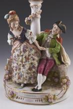 German Dresden Style Porcelain Figural Lamp, c. 1900, Sitzendorf, of a courting couple seated on a flower strewn wall, H.- 14 in., W...