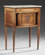 French Louis XVI Style Carved Walnut Marble Nightstand, early 20th c., the rounded edge highly figured creme marble over a frieze dr...