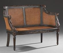 Louis XVI Style Carved Mahogany Settee, 20th c., the carved double caned back to caned curved arms, over a bowed caned seat, on turn...