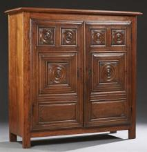Diminutive French Carved Oak Louis XIII Style Armoire, early 19th c., the stepped crown over double doors with relief carved panels,...