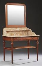 French Carved Mahogany Louis XVI Style Marble Top Washstand, early 20th c., with an arched mirror over a highly figured ocher marble...