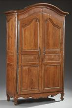 French Louis XV Style Carved Oak Armoire, early 19th c., the arched rounded corner stepped crown over two arched triple fielded pane...