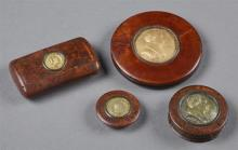 Group of Four Snuff Box Items, 19th c., consisting of two circular walnut snuff boxes with gilt metal portraits of General Lafayette...