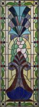 Victorian Style Leaded Slag Glass Window, 20th c., mounted with blue cabochon