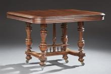 French Henri II Carved Walnut Dining Table, late 19th c., the stepped reeded edge top on turned tapered urn trestle supports, joined...